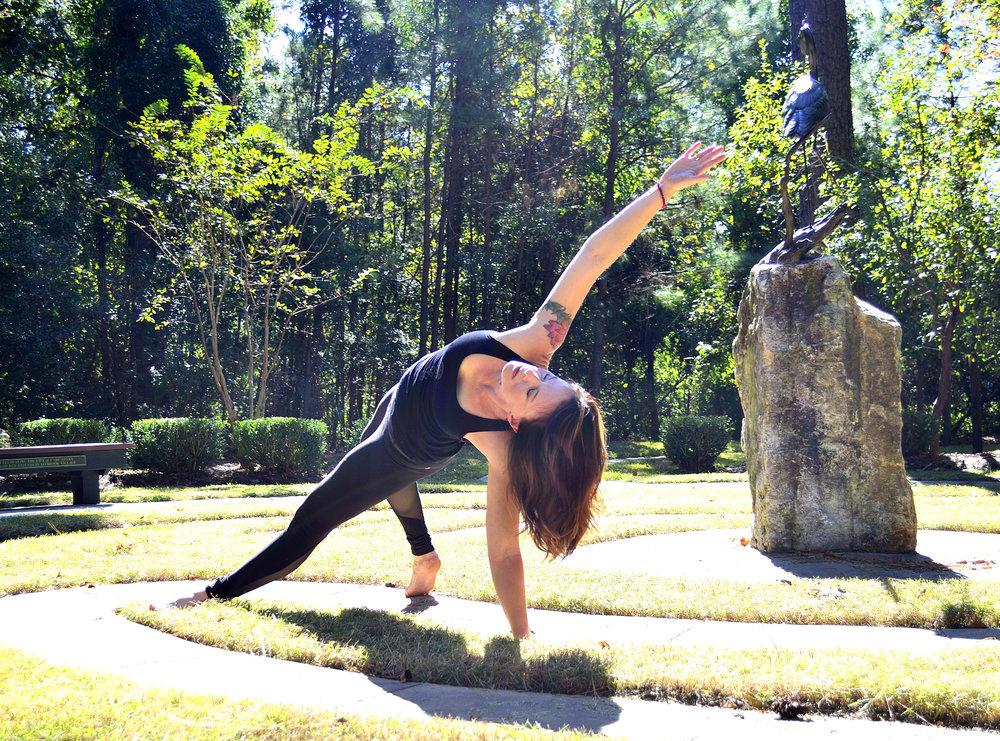 Angela doing yoga pose wild thing