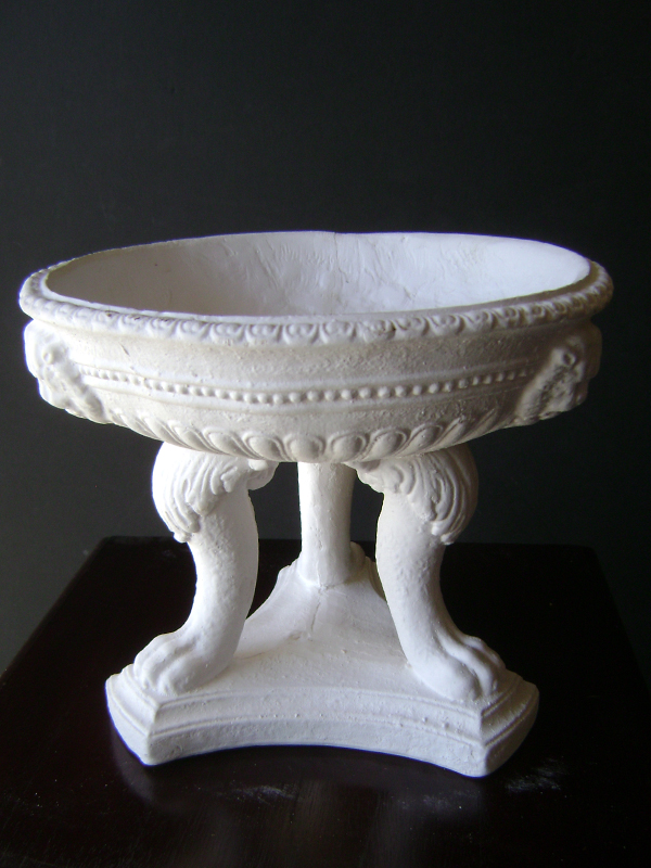 Plaster footed urn