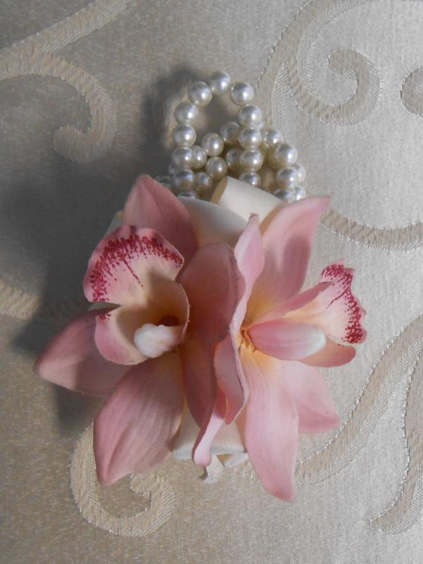 Pink cymbidium orchid corsage