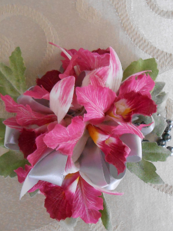 Dark pink orchid corsage