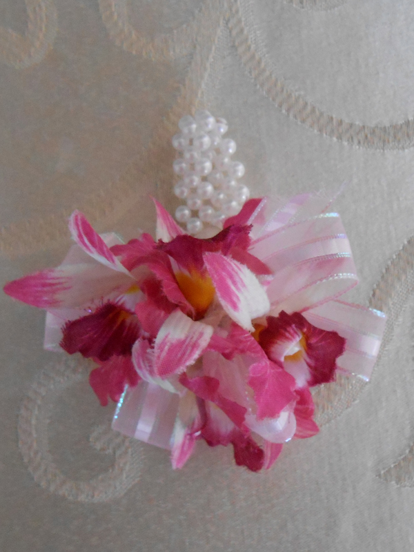 Deep pink orchid corsage with pearl wristlet
