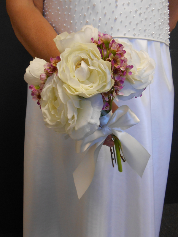 Small bridal bouquet with white renonculous and waxflower