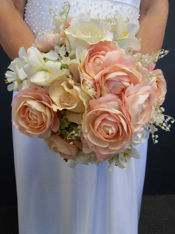 Lily of the valley with peach roses bridal bouquet