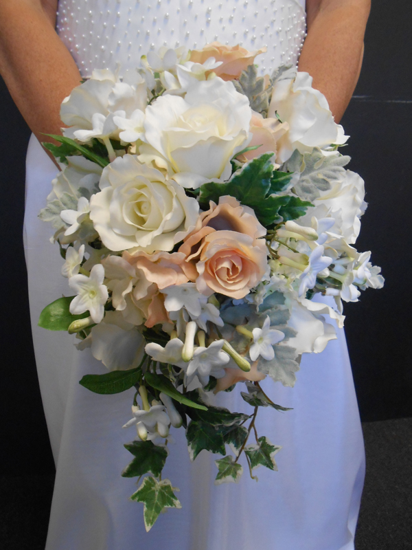 Cascade bouquet in white and peach