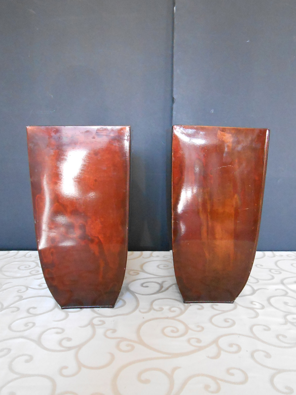 Tall red metal vase