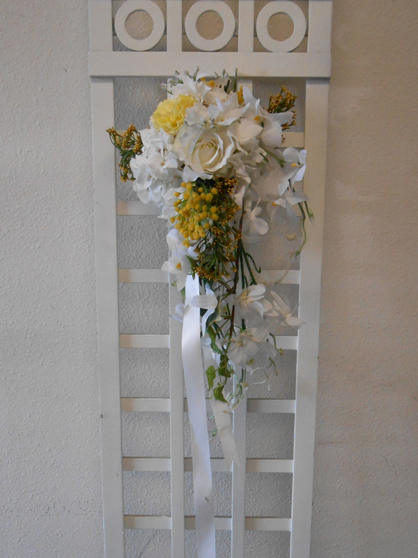 Hand tied pew floral