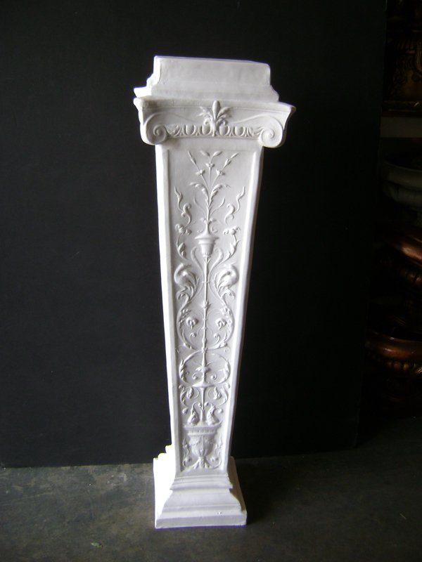 White plaster tall embossed pedestal