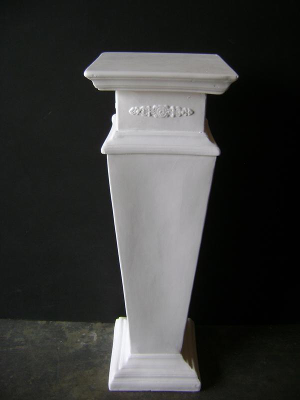 White plaster embossed pedestal