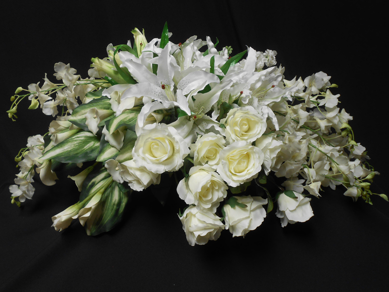 Whit lily and rose casket spray