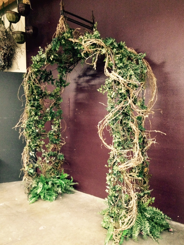 Gardeny green and grapevine iron arch