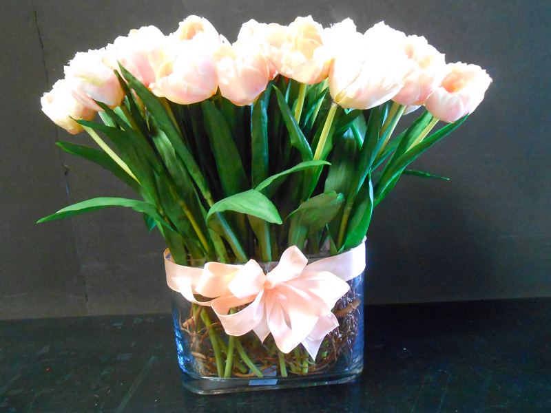 Peach French tulips in glass