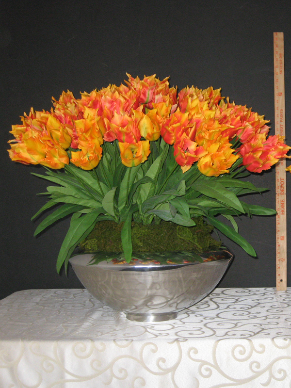 Orange parrot tulips in silver bowl