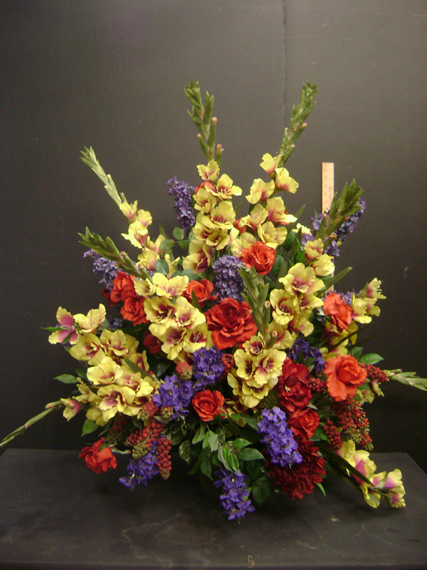 Primary colors funeral floral