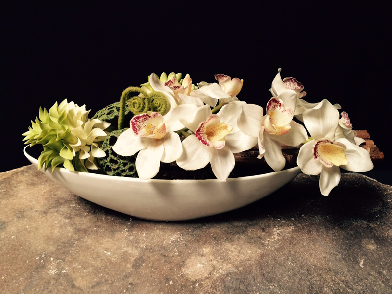 Oval white bowl with orchids