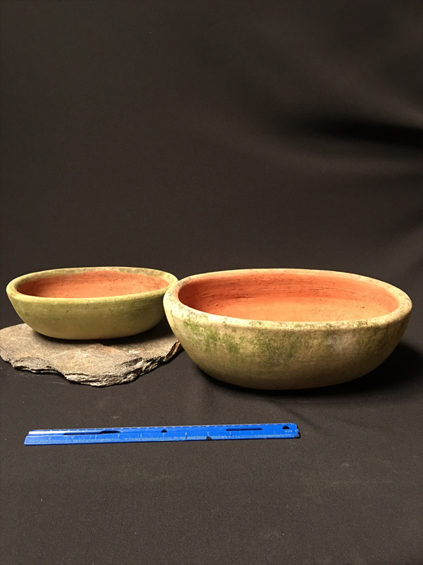 Aged terracotta bowls
