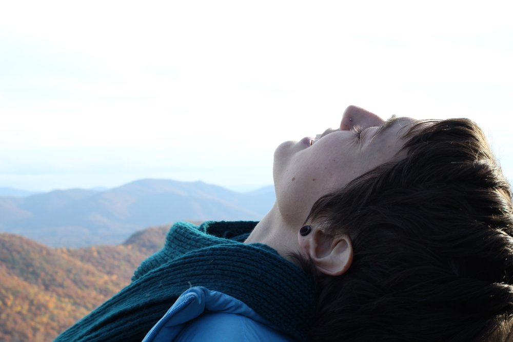 Me breathing in the life of the mountains, some time after my hike.