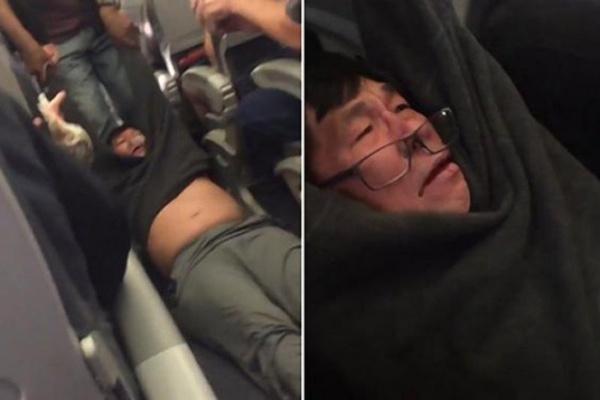 United Airlines cho nhân viên công lực kéo lêhành khách ra khỏi máy bay. Nguồn internet.