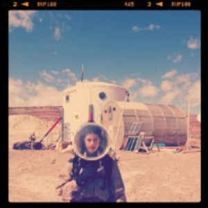Angeliki Kapoglou , is a systems engineer from Greece who has worked with NASA JPL, ISU, UCL, MDRS, CALTECH, ESA/ESTEC, CERN, to name a few. Angeliki had a hand in designing the Day in the Life for DSX students. Here she is at the Mars Desert Research Station.