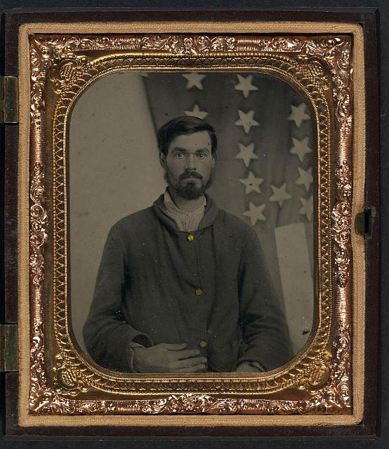Soldier in Union Sack Coat in Front of American Flag | Circa 1861-1865