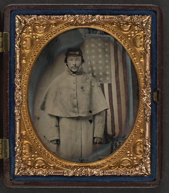 Soldier in Uniform in Front of American Flag | Circa 1861-1865
