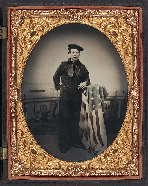 Young Sailor in Union Uniform with American Flag in Front of Backdrop Showing Naval Scene | Circa 1861-1865
