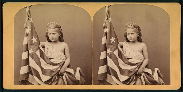 Little Girl Wearing a Gown and Crown, Unfurling an American Flag | Circa 1873