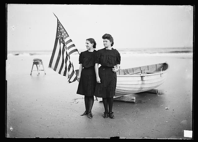 Women by Boat with Flag in Atlantic City | Circa 1890
