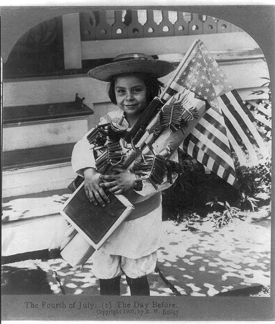 Child with the American Flag and Fireworks | Circa 1906