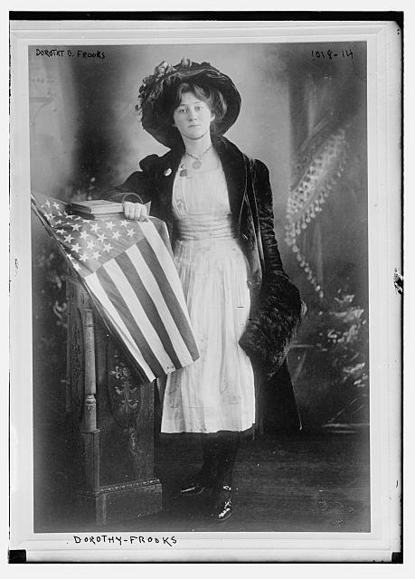 Dorothy D. Frooks Standing at a Flag-Draped Dais | Circa 1900