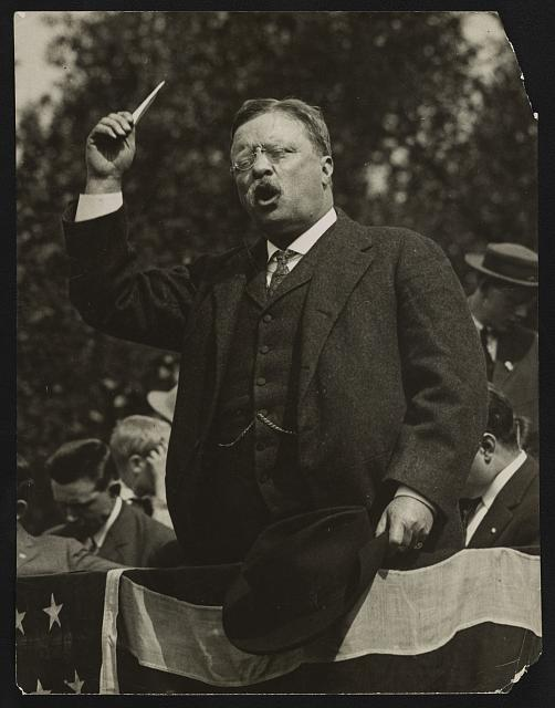 Teddy Roosevelt Speaking from a Flag Draped Platform | Circa 1900