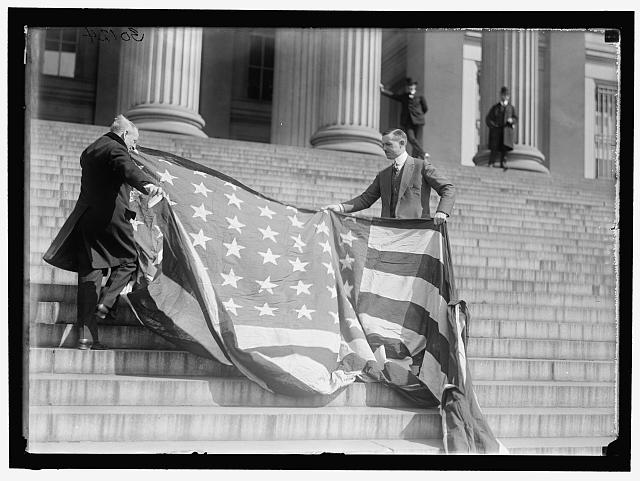 Carter Glass and F.R. Wilson with Capitol Flag on Treasury Steps | Circa 1919