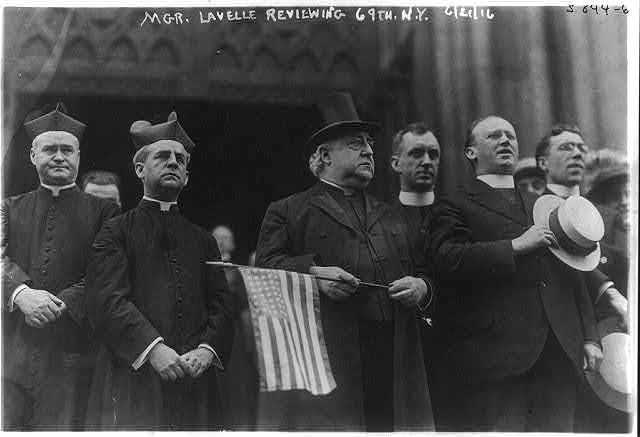 Mgr. Lavelle Holding U.S. Flag | Circa 1916