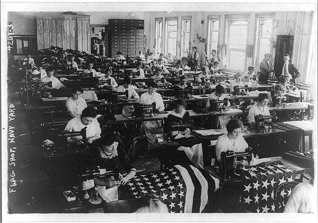 Navy Yard Flag Shop with Women Sitting at Sewing Machines Making Flags | Circa 1917
