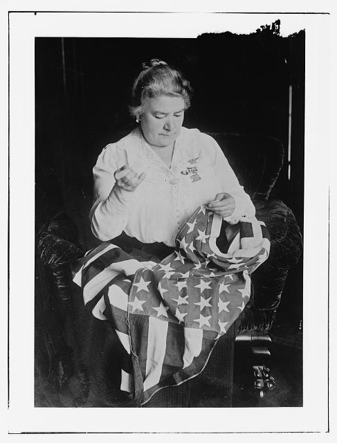 Schumann-Heinker Sewing a Flag | Circa 1900