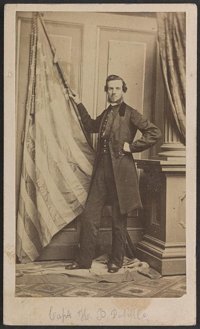 Harry B. Doolittle of Co. C, 2nd Iowa Infantry Regiment, Holding Regimental Flag and Standing on First National Flag of the Confederacy | Circa 1861-1863