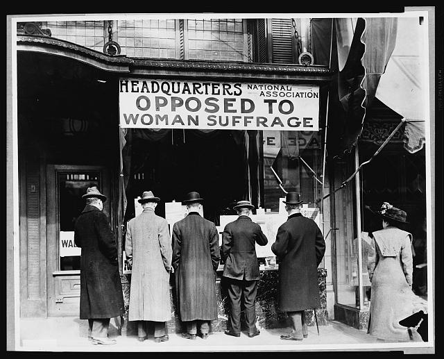 Men Looking at Material Posted in the Window of the National Anti-Suffrage Association Headquarters | Circa 1911