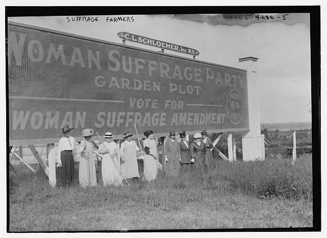 Suffragettes Standing in Front of a Billboard Supporting the Woman Suffrage Amendment | Circa 1917