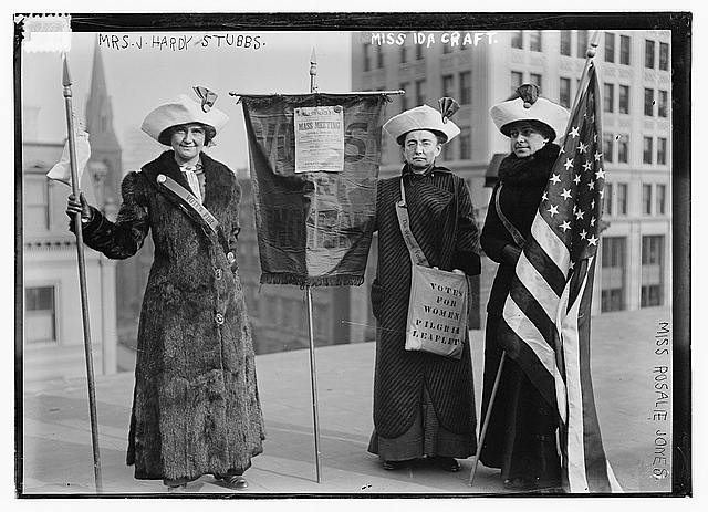 Three Suffragettes with Leaflets and the American Flag | Circa 1910