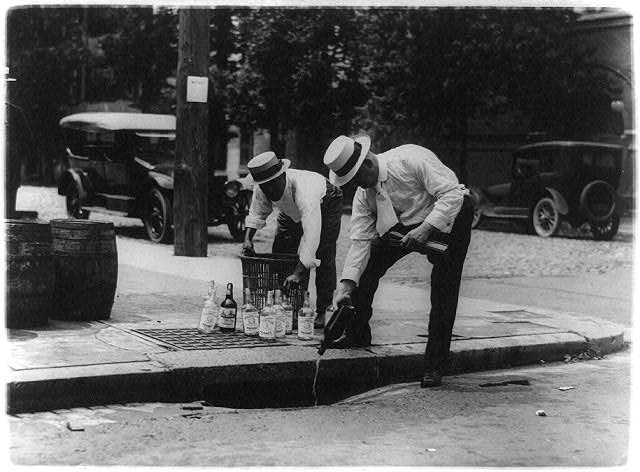 Pouring Whiskey into a Sewer | Circa 1909