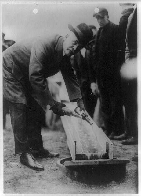W. Hurd Clendinen, Mayor of Zion City, Pouring Away Two Bottles of Beer | Circa 1921