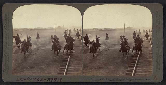 Cowboys Following the Train and Cheering President Roosevelt in Hugo, Colorado | Circa 1903