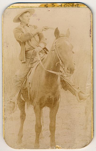 Will Roberts, Alias Dixon, a Cowboy Train Robber Pointing His Gun | Circa 1900