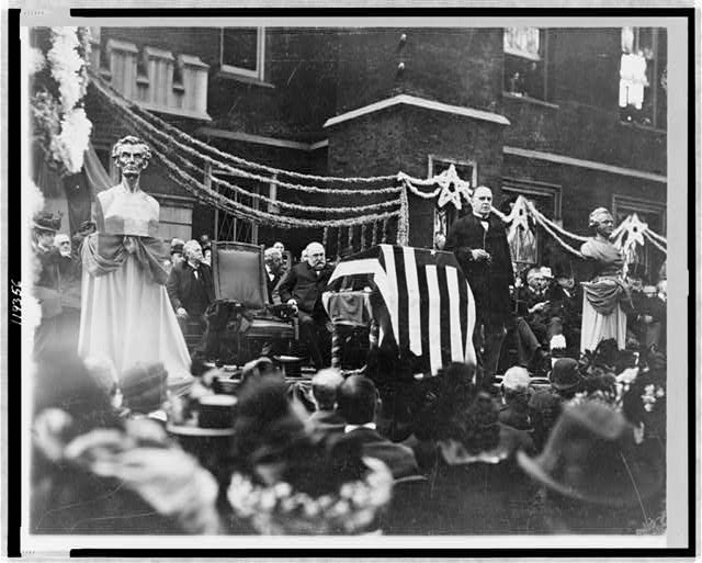 Anniversary of the Lincoln-Douglas Debate, McKinley Speaking in Galesburg, Illinois in Front of the American Flag | Circa 1899