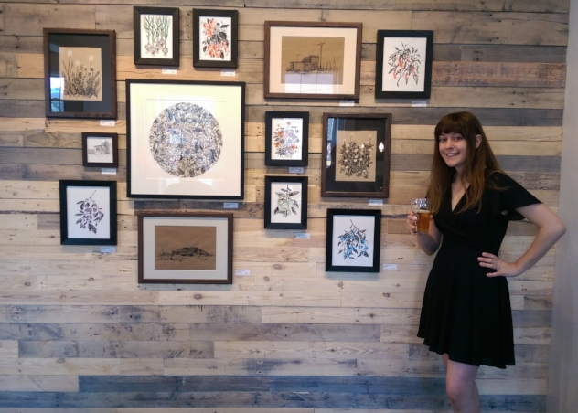ARtist maura o'connor in front of the feature wall