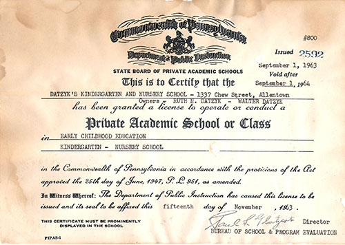 The certificate pictured here is Mrs. Datzyk's original license from 1963, when she first opened the doors to the Datzyk School.