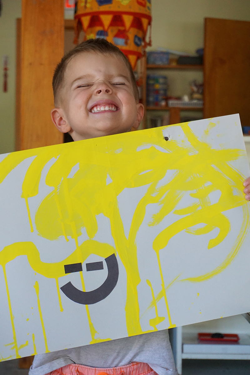 "Here's PV holding his painting saying, ""My smiley face painting looks just like me!"""