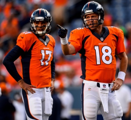 Denver Broncos quarterbacks Peyton Manning and Brock Osweiler.