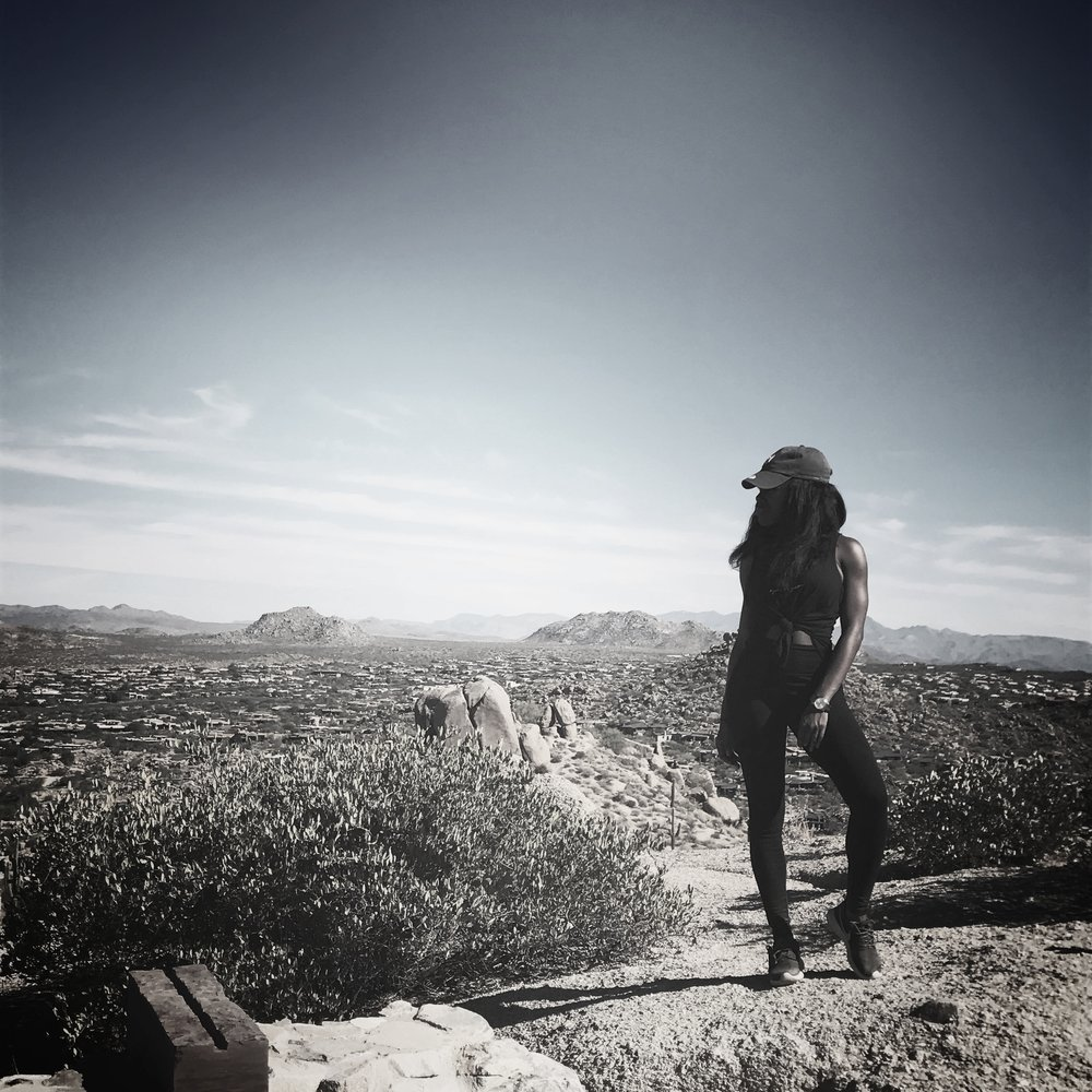 Our founder, Alana, wearing the 'higher thoughts' tank, while feeling victorious after completing a challenging hike in Arizona -- all due to the strength of her mind.