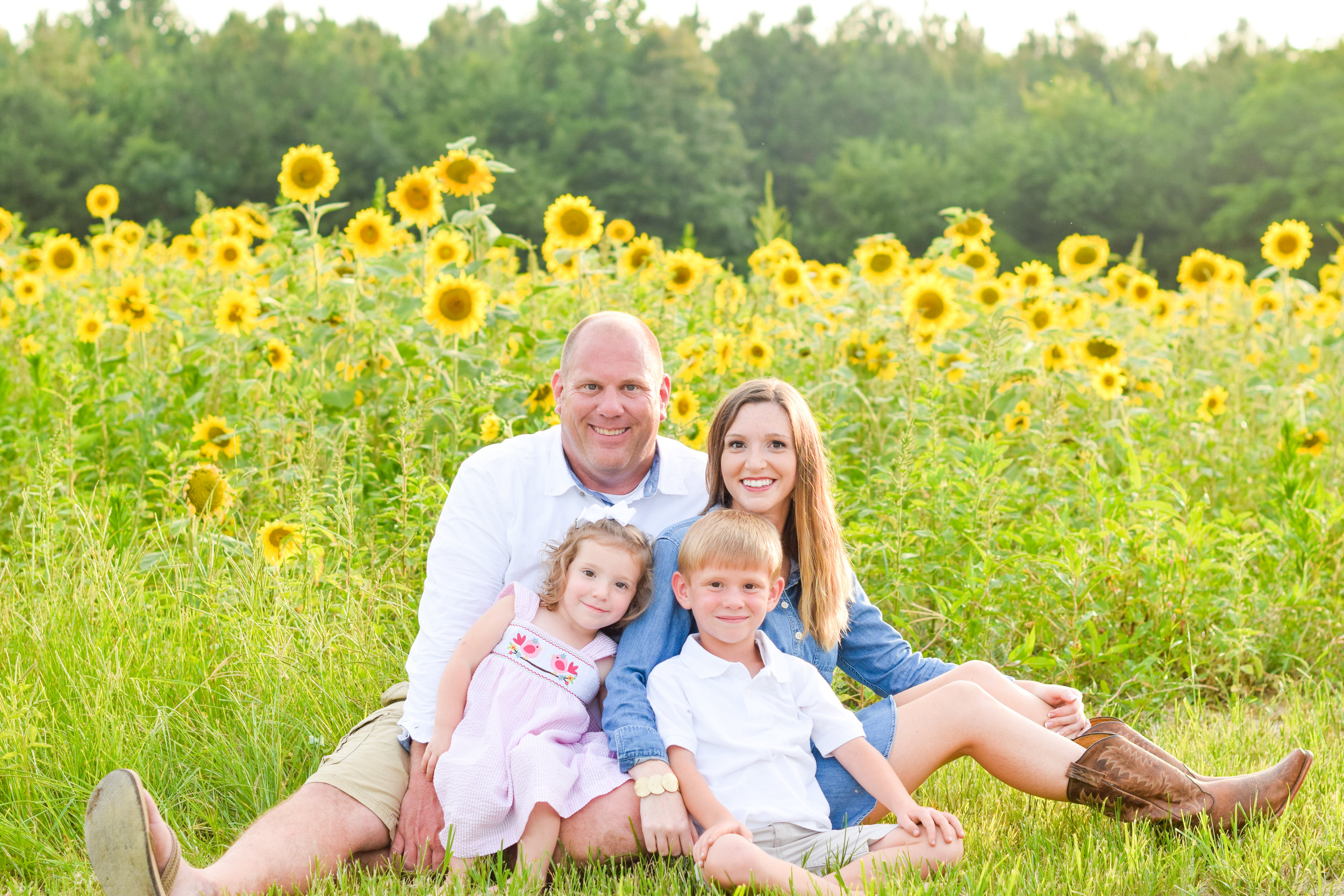 Abby is much more than a photographer, she's an artist! When my husband and I decided on doing family photos in our field of sunflowers she was totally on board. She even scheduled our session around making sure they were in their peek of blooming. She gave me pointers on what she thought would look the best on my family with the chosen background and gave me honest opinions on things that may not photograph as well. I appreciated that so much! She was also wonderful with our children and when she left they talked about her for days. We loved the way the pictures turned out. She will definitely be my go to photographer from now on. THANKS ABBY! Brittany