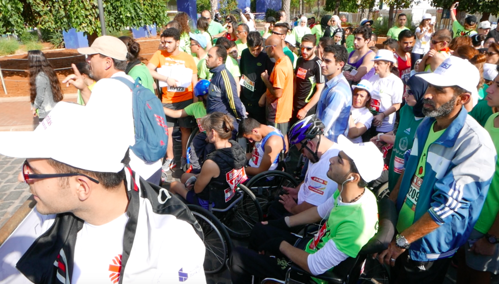 Adnan and his dad at the Beirut Marathon 2015. Photo by INARA staff.